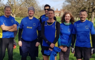 (L-R)Jonathan Price, Steve Roberts, Ben Cuthbert, Andy Buck, Ruth Cowlin and Gary Godfrey in front of Nether Hall in Pakenham for the 5-mile Bury Cross Country.