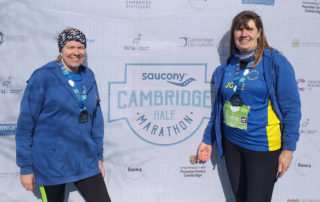 Claire Rooke (left) and Jodie Budd (right) after finishing the Cambridge Half Marathon.